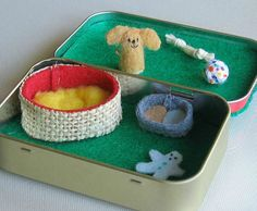 Fluffy dog plush in Altoid tin playset