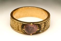 This gold 'posy' ring (that is, one with an inscription), set with a spinel (the stone), has a love message inscribed around the outside. It says 'pour amor, say douc', meaning 'for love, so sweet'. The inscription is in French, the language of courtly love in medieval times. Late Medieval; mid 15th century