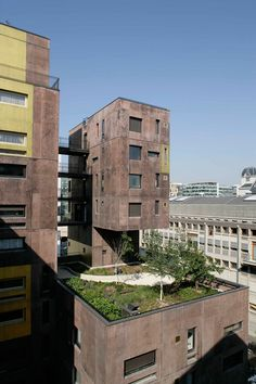 Beckmann-N'Thépé+.+ZAC+Masséna+.+Paris+(7).jpg 1.000×1.500 pixels #appartementen #materialisatie #bruin #goud #vorm #dakterras #daktuin #tuin #toren