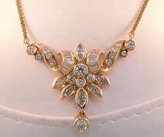 Elegant yellow gold and 2 carat total weight diamond pendant. www.randolphsjewelry.com