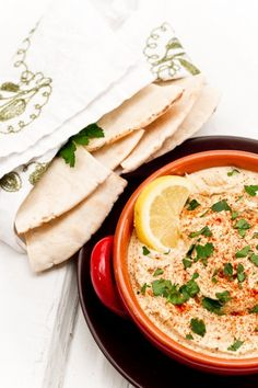 Yum!! Hummus and warm flat bread or pita. Great snack, appetizer or sandwich topping. Protein packed and pretty healthy too!!