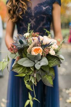 Gorgeous Wedding Bouquet Showcasing: Blue Eryngium Thistle,  Peach English Garden Roses, White Florals, Additional Coordinating Florals & Several Varieties Of Gorgeous Greenery/Foliage - photo by Gina Paulson Photography http://ruffledblog.com/fair-isle-of-scotland-wedding-inspiration