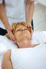 Woman receiving head massage stock photo
