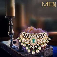 Bridal polki choker with black enamel, emerald & south sea pearls. #MBj #Luxury #Desirable #Glamour #Jewellery #Polki #Traditional #Pearl #Emerald