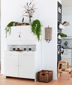 Look how much function this family squeezed out of this small wall. They hung horizontal racks (this looks like GRUNDTAL rails and hooks from IKEA) to hold herbs, utensils and towels.