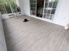 """""""wood"""" tile planks. exactly what we need for the sunporch. maybe a little darker & more wood looking tiles though."""