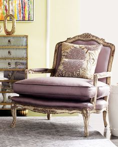 """""""Olivia"""" Chair by Old Hickory Tannery at Horchow: A sophisticated shade of lavender sets this chair apart from the rest, while a leafy floral pattern on its two pillows provides extra interest."""