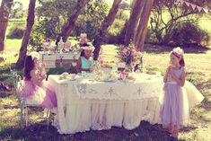 A gorgeous Vintage Tea Party with dressy dresses for twirling in a beautiful forest setting.