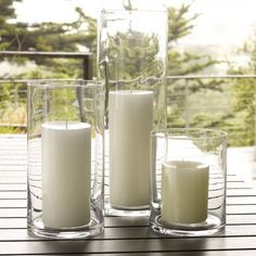 Hurricane lantern candle holders earned their name because their tall chimneys protect a flame from wind. Not sure if they could stand up to a real hurrica