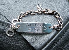 Fifty Shades of Grey Quote Laters Baby Hand Stamped Bracelet. $17.00, via Etsy.