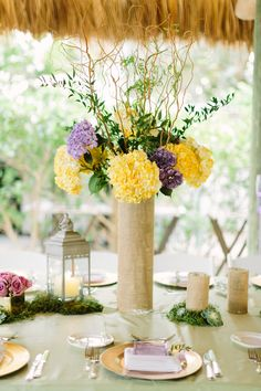 Lavender and yellow centerpiece // see more: http://theeverylastdetail.com/romantic-lavender-and-yellow-wedding/ // Photographer: Bob Care Photography / Wedding Planner/Coordinator: Destination Wedding Studio / Flowers & Decor: Floral Fantasy
