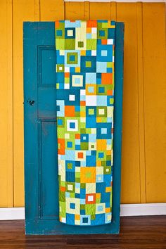 Seeing Squares quilt by emptybobbin, via Flickr - I love the color combination in this quilt, the wall, the door, the whole thing!