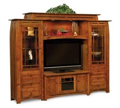 Amish Boulder Creek Mission Entertainment Center The ultimate in solid wood entertainment centers. Stunning collection of storage options. Built by hand in choice of wood, stain and features. #entertainmentcenter #livingroom