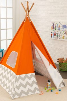 A teepee is the perfect place for a kid to play! A little one would love to hide inside and throw a tea party or build a city out of blocks. Or you could fill it with throw pillows to create a reading nook. It has windows to let in light! And when playtime is over, the teepee can fold up like an umbrella for storage.