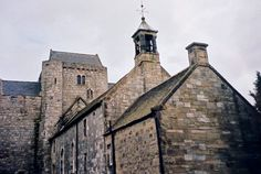 Photo taken by Joyce Sandilands of Canada in 2002 of the Torphichen Preceptory (on left & tall building at back) and Church (front of photo), Village of Torphichen, West Lothian, Scotland.