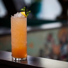 "FUNCHO DANÇA:  - 1.5 oz Novo Fogo ""Chameleon""  - 1.5 oz fresh-squeezed orange juice  - 0.5 anisette  - 0.25 oz Hayman's Sloe Gin  - 2 dashes Aromatic Bitters  Build in a tall glass with crushed ice and swizzle to mix."