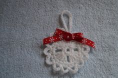 Snowflake ornament with snowflake red ribbon bow  and red button accent by CreativeCrochetbyChris, $4.00 USD