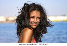 Girl with tousled hair on the beach. - stock photo