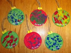 Christmas ornament kids craft - could cut paintings into these shapes.