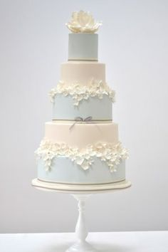 Sophisticated, elegant wedding cake in soft blue and ivory, with sugar flowers. Your wedding cake is an important feature of your wedding, so shouldn't be some slapped together 5th grade craft project. It should beautiful, with wow factor.
