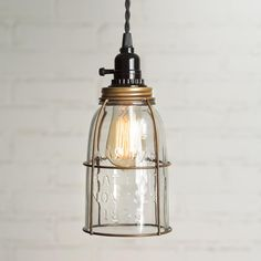 """Antique Brass Half Gallon Caged Mason Jar Pendant Lamp Measures 4½"""" dia. and 11¼"""" high Includes a half gallon mason jar with no bottom 15½ foot cloth-covered lamp cord with switched socket 2finished ceiling hooks 2 cord clamps for adjusting the height of the lamp, Easy-to-follow instructions. These lamps plug into any"""