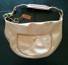 Medium crescent shaped Coach purse w/leather trim and gold sateen fabric.