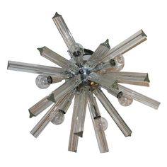 A Venetian Snow Flake Flush Mount / Sconce  Italy 1960    One of these would be so great as an art piece over a fire place or in my dining room.