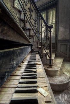 Silent Keys ~~ Old, Forgotten Piano sits at the bottom of a Beautiful Staircase in an abandoned building. So sad the piano was forgotten! I would just love to fix it up and play a symphony on it! Abandoned Buildings, Abandoned Mansions, Old Buildings, Abandoned Places, Jolie Photo, Haunted Places, Architecture, Old Houses, Beautiful Places