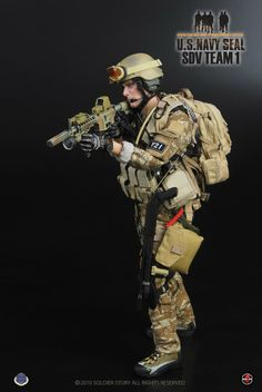 US Navy SEAL SDV Team 1, looks like a pack mule, or as I call em asss, that's an actor in brand new gear,,,,