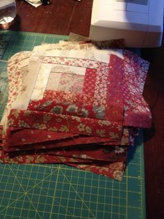Jen Crutchfield: How to keep the dining room table clean (French General log cabin quilt blocks).