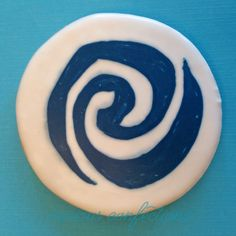 Moana symbol sugar cookies - piped with royal icing. For a moana birthday party. By Kathleen at curious confections in NJ. Instagram: curious.confections