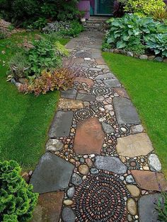 Landscape/Yard with Blue Ridge Stone Company Medium River Rounds, Stone pathway, exterior stone floors, Raised beds, Pathway