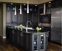 Not really anything negative I can say about this!  Love the dark cabinets, curvey island, dark backsplash, and modern pendant lights!