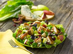 Wendy's Apple Pecan Chicken Salad    A perfect mix of peak-season red and green apples, real blue cheese crumbles, sweet cranberries and roasted pecans, topped with a warm, (optional) grilled chicken fillet.        Wendy's when on the go but wonderful and more healthier when created at home use leafy greens instead of iceberg.