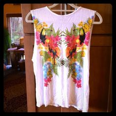 Tropical Toucan shirt Tropical toucan shirt. Sleeves are cut off purposely on this amazing colorful and fun t-shirt. Pricing high because not sure I want to sell. Price firm. Atmosphere Tops Muscle Tees