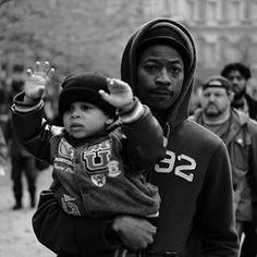 #BlackLivesMatter 29 Moments That Show Another Side Of The Baltimore Riots  Young hoodie with his little boy with raised hands-a picture of the problem.  Teaching them defiance. Another future demonstrator who will grow up hating the Police and the White man.