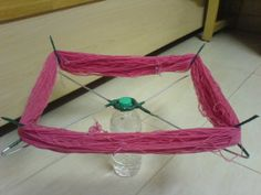 DIY yarn swift made out of coat hangers, a PVC ring and bottle! Love it!