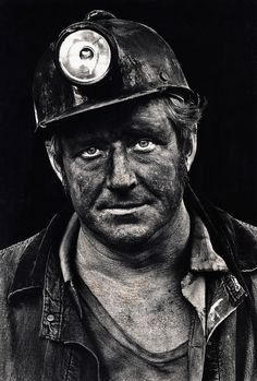 Coal miner Lee Hipshire in 1976, shortly after emerging from a mine in Logan County, W.Va. at the end of his shift. At age 36, he had worked 26 years underground. A few years later, Lee took early retirement because of pneumoconiosis, or black lung disease. He died at 57. correction after new info: Jennings Harvey Howes,, taken `48 to 1951 when his brother Joe died from a coal mine accident 1951.
