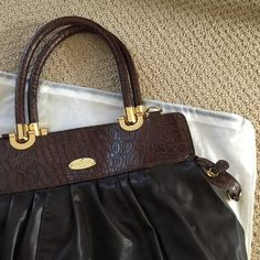 Romeo Gigli bag Romeo Gigli bag. Some wear as pictured, but has a lot of life left. Made in Italy. Included brand new shoulder strap still in plastic. Romeo Gigli Bags