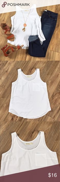 White flowy sleeveless blouse with pocket White flowy sleeveless top is 100% polyester and very lightweight. Add a pair of skinny jeans and some ballet flats for a cute date night outfit. Machine wash. Never worn, only washed. Faded Glory Tops Blouses