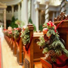 Winter Wedding Pew Decor. Ceremony pews were decorated with bundles of evergreen, pinecones, and seasonal fruits.
