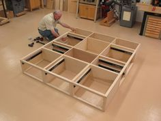 Custom ash king-size storage bed with 9 drawers. Matching headboard and nightstands.