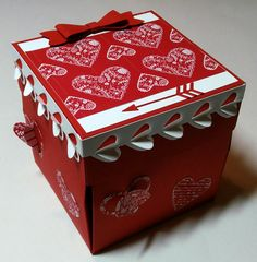Are you planning for Valentine's Day soon enough? Don't wait long because this box is a limited edition, elaborate and beautiful bright red and white smooth Stampin' Up! paper, each layer hiding more surprises.  Images are from the Stampin' Up! stamp and die sets.  Watch for my You tube video coming soon to feature this box.