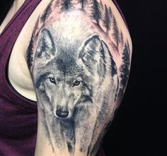 Realistic portrait style wolf tattoo. Black and grey shade animal tattoo. Wolf head and tree half sleeve.