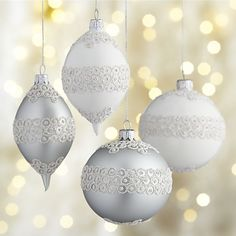 Silvery, lace-like circles on matte silver or white lend an Art-Deco feel to these stylish ball and drop ornaments. Each hand-decorated, blown-glass ornament is skillfully crafted by Polish artisans using time-honored techniques.
