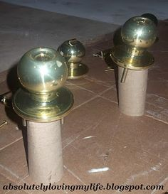 good tip for spray painting door knobs - stand them up in a tp roll