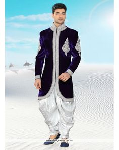 Significant Deep Violet And White Groom Sherwani With Dhoti ✔ Occasion Wedding Wear ✔ Collection Groom Wear Men's Collection ✔ Color Violet, White ✔ Fabric Velvet ✔ Work Zari work, Stones ✔ Season Any ✔ Weight 5 K.G. ✔ Dhoti Pants For Men, Wedding Men, Blue Wedding, Groom Wedding Dress, Ethnic Wedding, Sherwani Groom, Mens Sherwani, Wedding Sherwani, Wedding Designs