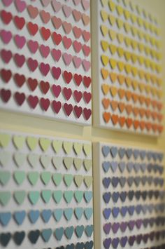 cute idea using paint chips from the hardware store and paper punches - create rainbow wall decorations