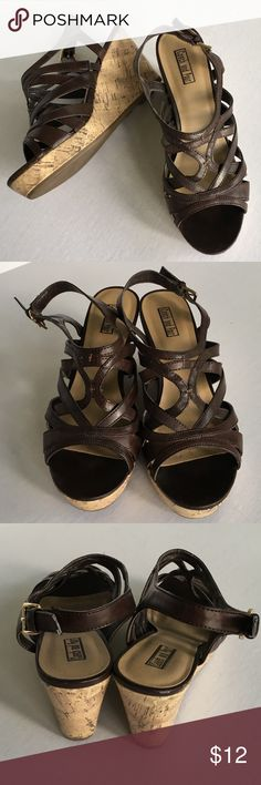 """$5 SALE! Brown Slingback Wedge Sandals Size 7 Really cute strappy, buckling adjustable Slingback wedge sandals by Coach and Four. US Women's size 7. Perfect with skirts, dresses, shorts, jeans, Capris... ANYTHING!  They are 3.5"""" wedge cork heels with a 1"""" platform. Coach and Four Shoes Sandals"""