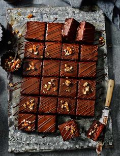 A salty caramel sauce cuts through the richness of this chocolate torte with caramelised pecans.